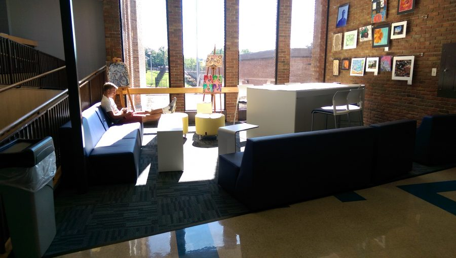 MJ Griesmer enjoying the chic new study space. (PHOTO BY JUDE HART)