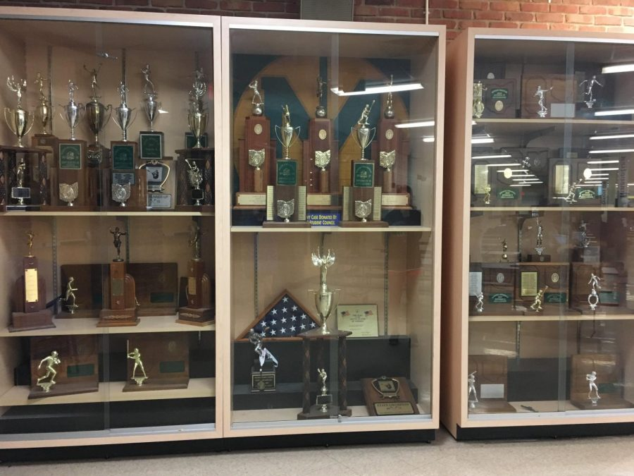 (PHOTO BY ZOBRIST)The trophy case in the cafeteria holds district and state runner-up and championship trophies.