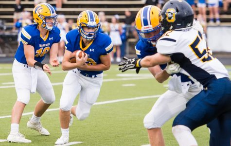 Luke Robinson looks downfield in the Warriors' victory over Oakwood.  Despite the small roster, the team is seeing success. (Photo by Spooner)