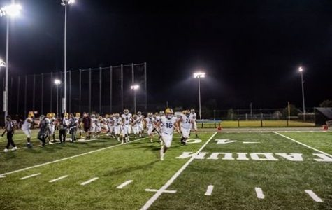 (PHOTO BY @d311rod) The team storms the field.