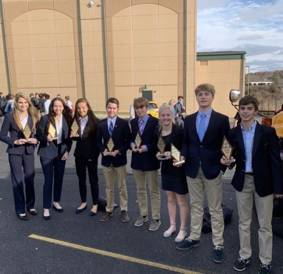 Ellie Trubisky (11), Sarah Comer (9), Mary Tully (10), Ryder Osgood (9), Timmy Ackerman (9), Lucy Lysaght (9), Mark Morgan (9), and Thomas Sauter (9) stand outside of Harrison High School following the competition. (PHOTO BY @mariemontdeca on Instagram)