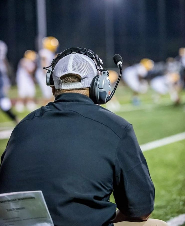 Coach Commins on the sidelines of a 2019 football game. (PHOTO BY Four Js Photography)