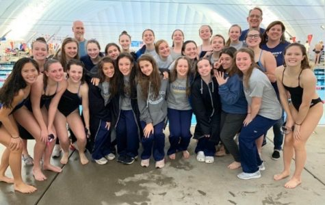 (IMAGE FROM BONNELL) The Girls Swim Team poses following Districts.