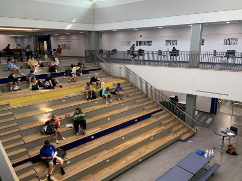 Students on the stairs of the new hub (BY NATALEE SHRIVER)