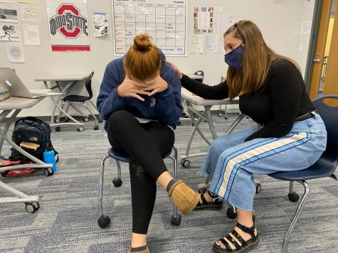 Junior Cricket Collister consoles senior Olivia Simpson as she is stressed about college applications.