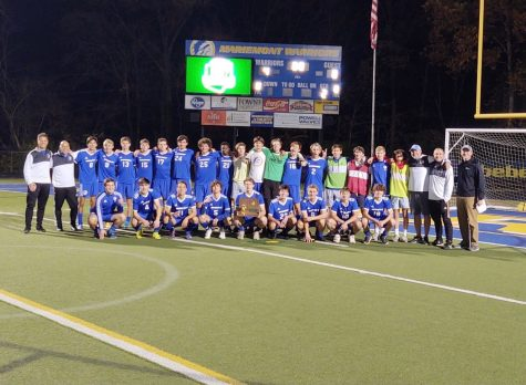 Boys Soccer holds Regional Championship trophy after defeating Botkins 4-0 on Saturday. (Photo from @mmontad on Twitter)
